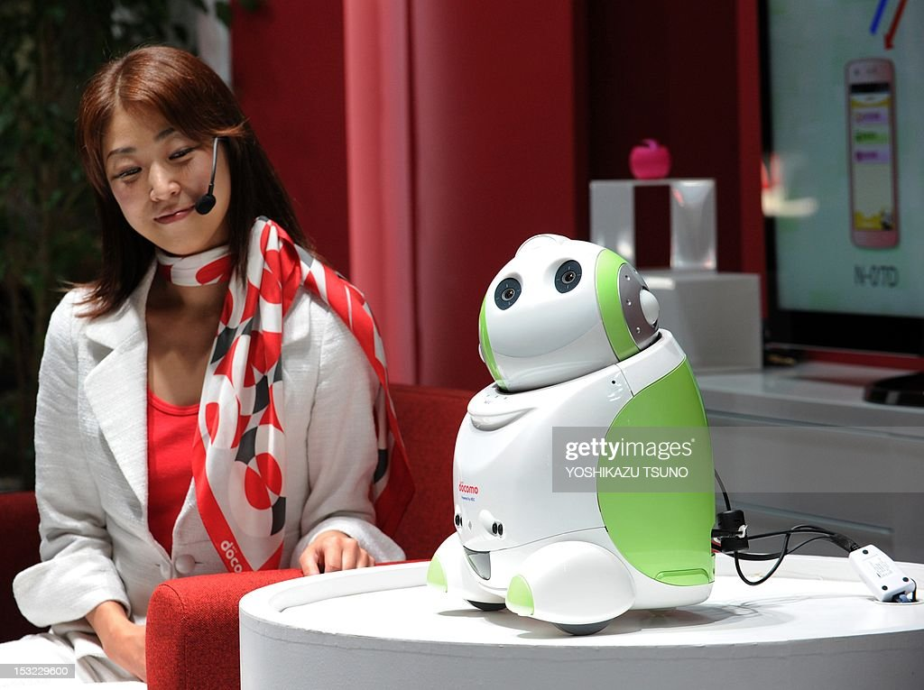 Japanese mobile communications company NTT DoCoMo demonstrate a robot (R), which recognises its user's voice and provides interactive and personalised assistance, at Asia's largest electronics trade show CEATEC (Cutting-Edge IT & Electronics Comprehensive Exhibition) in Chiba, suburban Tokyo on October 2, 2012. Some 600 Japanese and foreign companied exhibit their latest technology and products. AFP PHOTO / Yoshikazu TSUNO