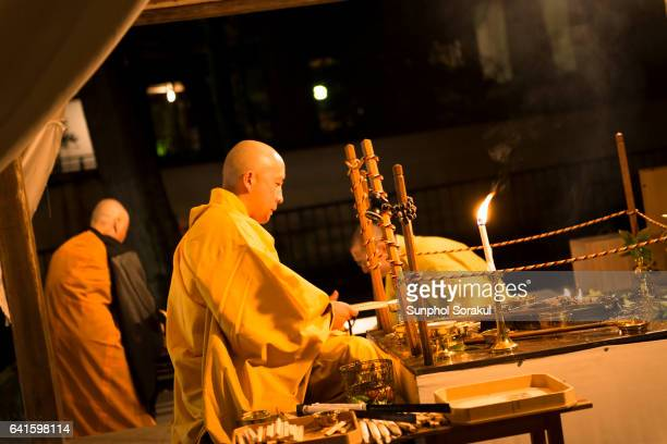 A japanese Monk Chanting sutra during the moon viewing festival