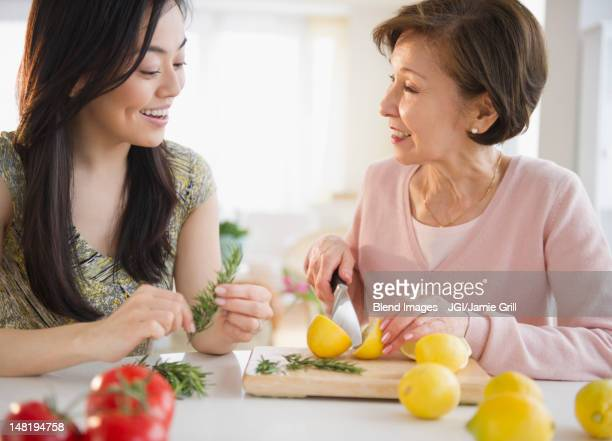 Japanese mother and daughter cooking together