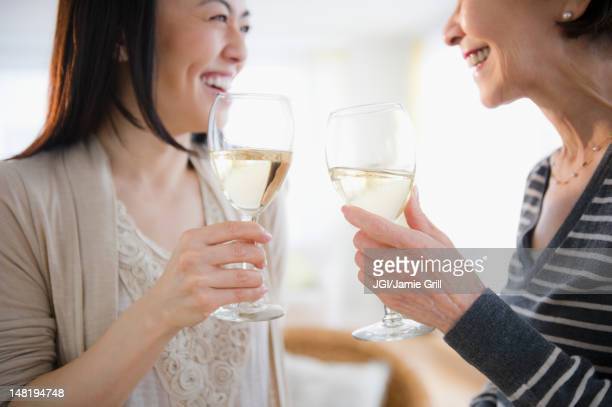 Japanese mother and daughter drinking white wine