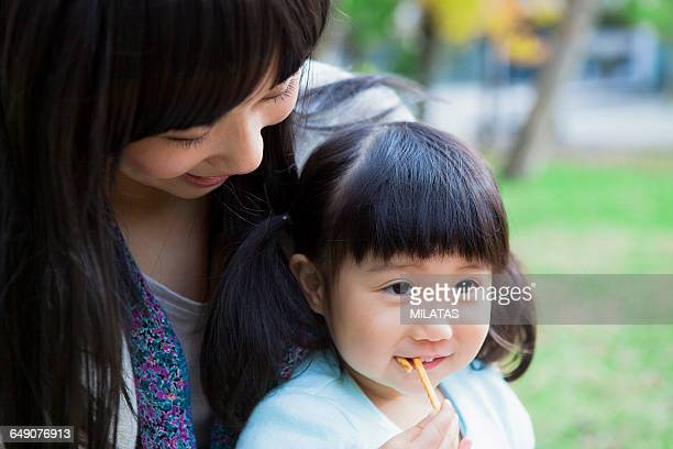 Japanese mother and daughter eating sweets