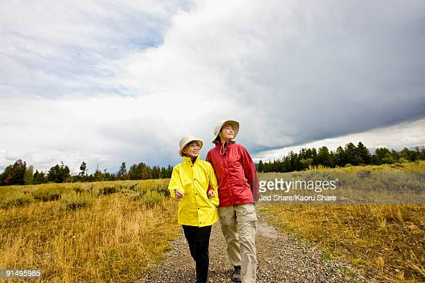 Japanese mother and daughter hiking in remote area