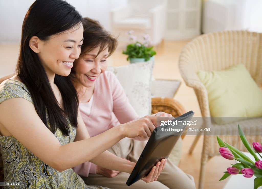 Japanese mother and daughter using digital tablet