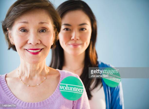 Japanese mother and daughter wearing volunteer stickers