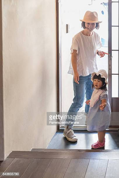 Japanese Mother and Young Daughter Leave Home for a Walk