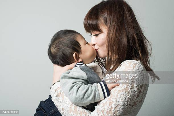 Japanese mother kissing her baby