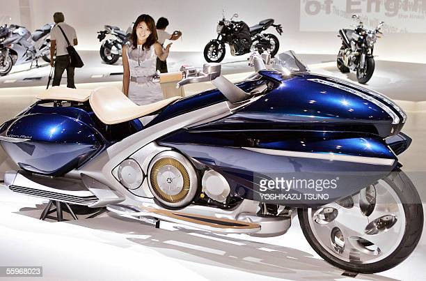 Japanese motorcycle giant Yamaha unveils the concept model of a highperformance hybrid motorcycle the 'GenRyu' equipped with a 600cc engine and...