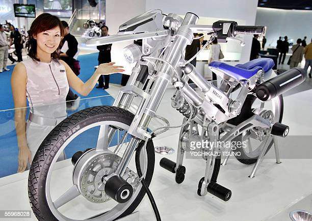 Japanese motorcycle giant Yamaha unveils the concept model of a stylish electric motorcycle the 'Deinonychus' equipped with two inwheel motors to...