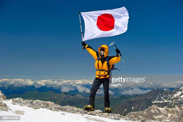 Japanese mountaineer flying the national flag of Japan.