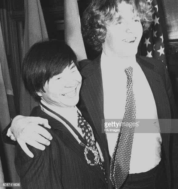 Japanese mountaineer Naomi Uemura gets a hug from 17yearold Teddy Kennedy son of US Senator Edward Kennedy at London's Guidhall after the 37yearold...