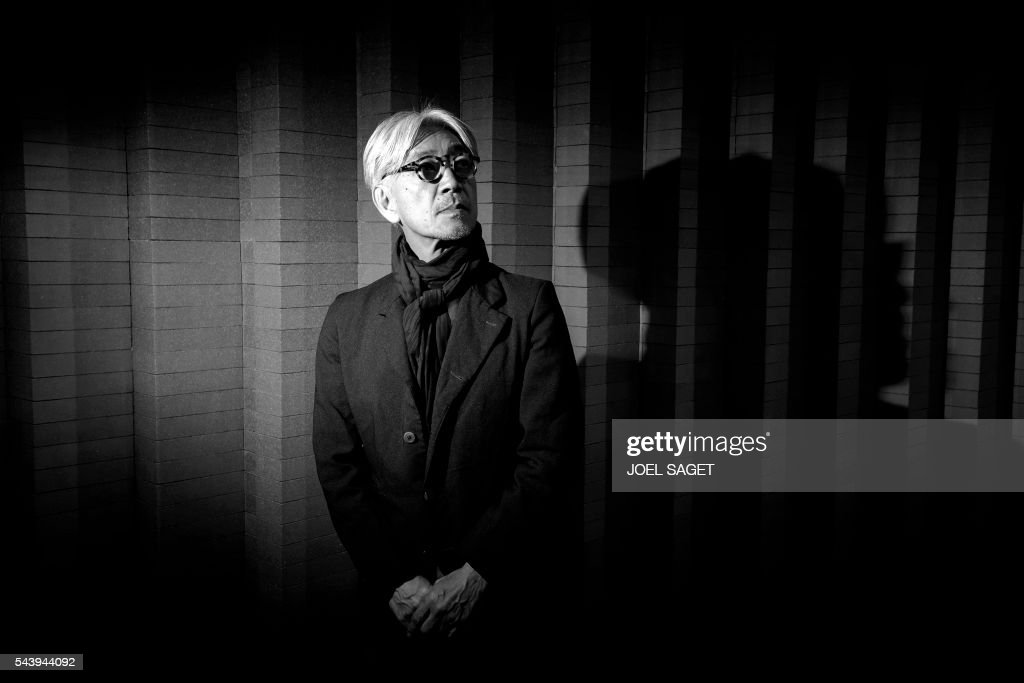 Japanese musician, composer, record producer, pianist, activist, writer, actor and dancer Ryuichi Sakamoto poses on June 30, 2016 in Paris. / AFP / JOEL