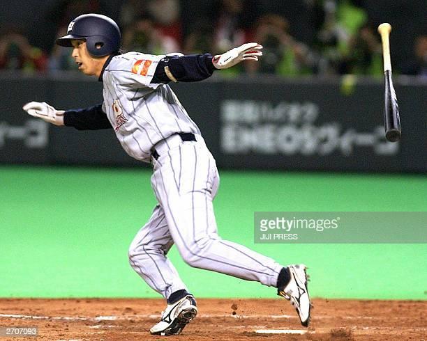 Japanese national baseball team captain Shinya Miyamoto makes a hit during the Asian Asian Baseball Championships against South Korea at the Sapporo...