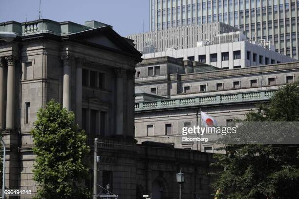 A Japanese national flag flies outside the Bank of Japan headquarters in Tokyo Japan on Friday June 16 2017 Global stocks rose with shares in Japan...