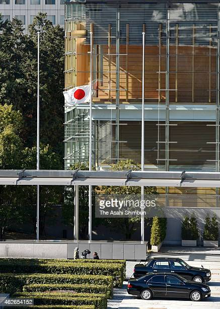 Japanese national flag is hoisted at halfmast to offer condolence to killed journalist Kenji Goto at Prime Minister Shinzo Abe's official residence...