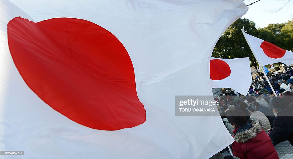 Japanese national flags flutter during a rally denouncing China organized by a nationalist group in Tokyo on February 23, 2013. Several hundred people took part in the event. AFP PHOTO/Toru YAMANAKA