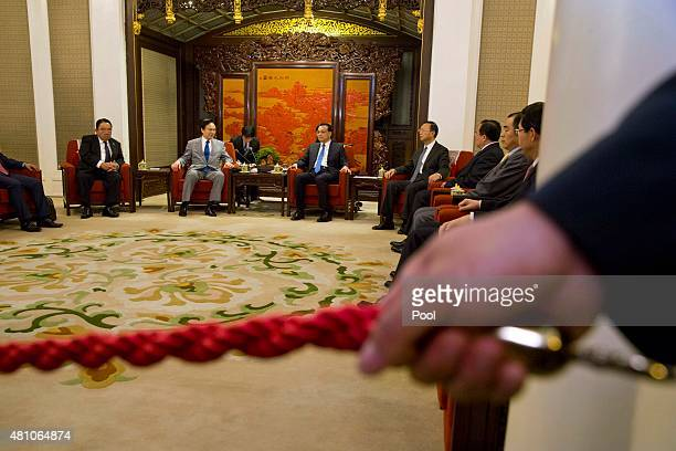 Japanese National Security Adviser Shotaro Yachi left meets with Chinese Premier Li Keqiang at the Zhongnanhai leadership compound on July 17 2015 in...