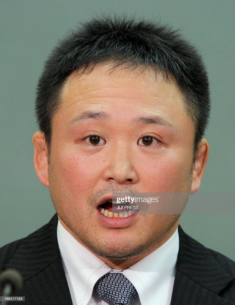 Japanese national women's judo head coach Ryuji Sonoda announces his resignation in Tokyo on January 31, 2013 after allegations emerged he had beaten his athletes with wooden swords. Sonoda offered an apology and a deep bow at a press conference. He said the claims made by a 15-strong group of judokas of physical punishment, including face-slapping, were 'more or less true'.