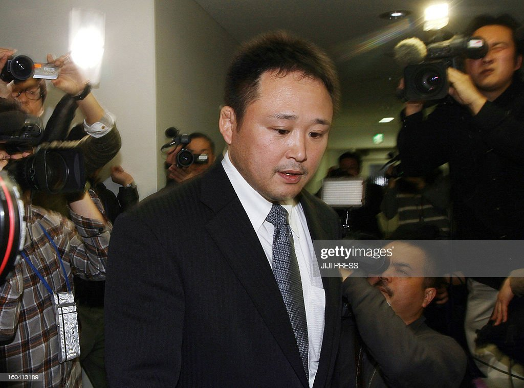 Japanese national women's judo head coach Ryuji Sonoda enters a room to announce his resignation in Tokyo on January 31, 2013 after allegations emerged he had beaten his athletes with wooden swords. A group of female judokas, including some who took part in the London Olympics, had complained to the Japanese Olympic Committee that they had been physically abused. JAPAN