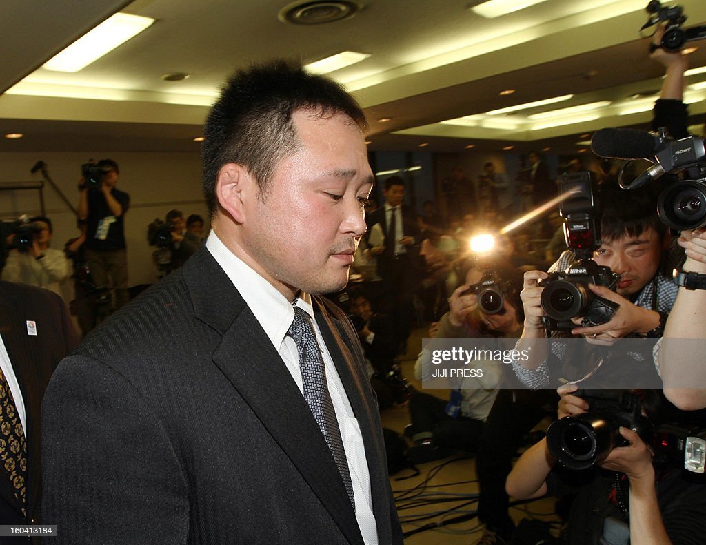 Japanese national women's judo head coach Ryuji Sonoda leaves after announcing his resignation in Tokyo on January 31, 2013 after allegations emerged he had beaten his athletes with wooden swords. A group of female judokas, including some who took part in the London Olympics, had complained to the Japanese Olympic Committee that they had been physically abused. JAPAN