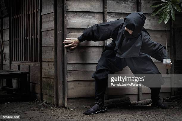 Japanese Ninja with Sword Hiding Behind Building Ready to Ambush