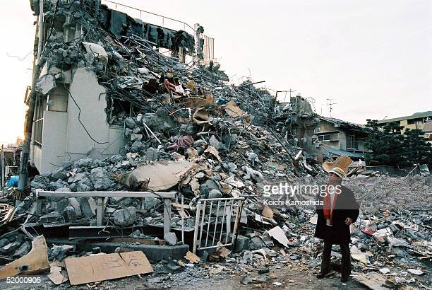 Japanese novelist Akiyuki Nosaka who was raised in Kobe surveys destroyed buildings near where he grew up after the massive earthquake that killed...
