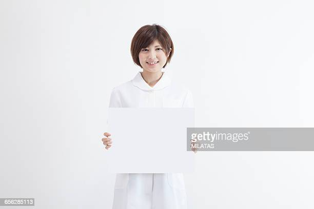 Japanese nurse with a white board