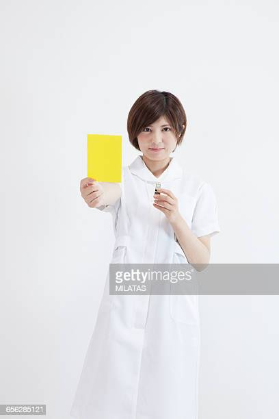 Japanese nurse with a yellow card