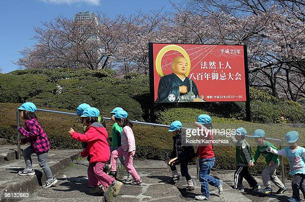 Japanese Nursery school children visit the Zojoji Temple as cherry trees are in full bloom on March 30 2010 in Tokyo Japan The cherry blossom season...