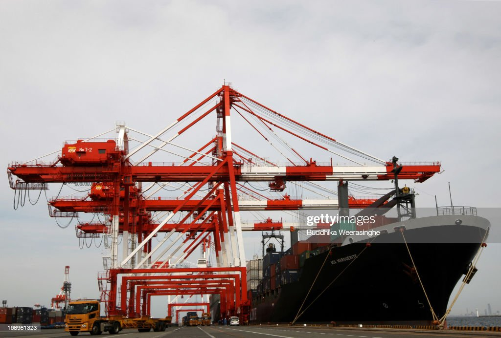 A Japanese NYK Group container ship is moored at international shipping terminal on May 18, 2013 in Kobe, Japan. Japan's economy recently shows the sign of recovery as the growth of last quarter was 0.9 percent, or 3.5 percent on annual basis.