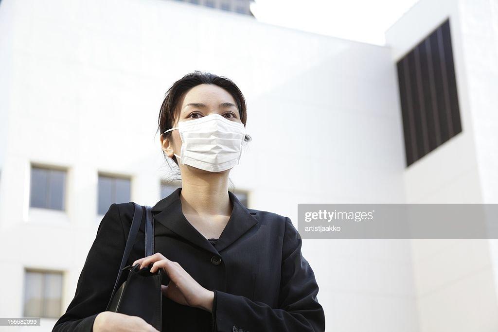 Japanese Office Lady Wearing a Mask : Stock Photo