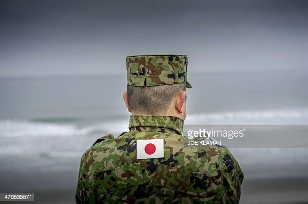 A Japanese officer from the Japan Ground SelfDefense Force watches his troops come ashore on Combat Rubber Raiding Craft during the US JAPAN military...