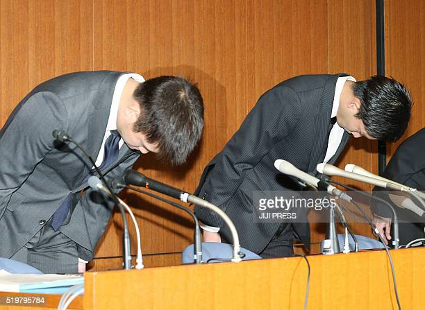 Japanese Olympic badminton medal hope Kento Momota and Kenichi Tago bow to apologise prior to the start of their press conference in Tokyo on April 8...
