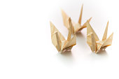 Japanese origami - Three paper cranes in wood grain paper. Japanese traditional paper craft.
