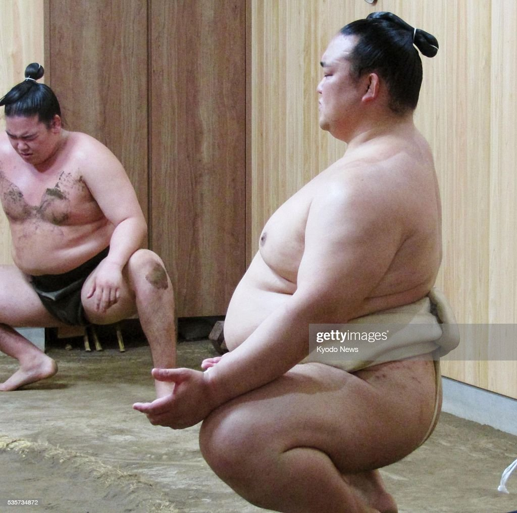Japanese ozeki Kisenosato (R) resumes training at his Tagonoura stable in Tokyo on May 30, 2016, after falling short of winning his first career Emperor's Cup at the Summer Grand Sumo Tournament earlier in the month. Kisenosato will try to put in a strong performance at the Nagoya meet in July to earn promotion to yokozuna.