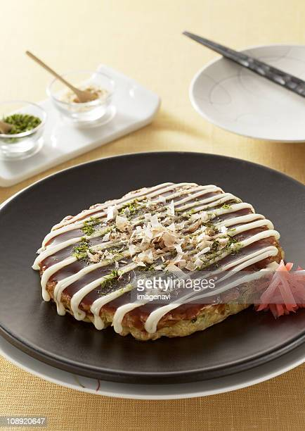 Okonomiyaki Stock Photos and Pictures | Getty Images