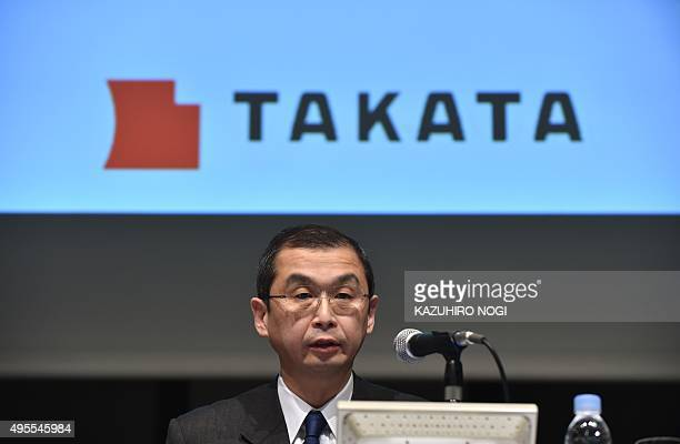 Japanese parts supplier Takata Corp President Shigehisa Takada answers questions during a press conference in Tokyo on November 4 2015 US auto safety...
