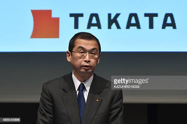 Japanese parts supplier Takata Corp President Shigehisa Takada holds a press conference in Tokyo on November 4 2015 US auto safety regulators...