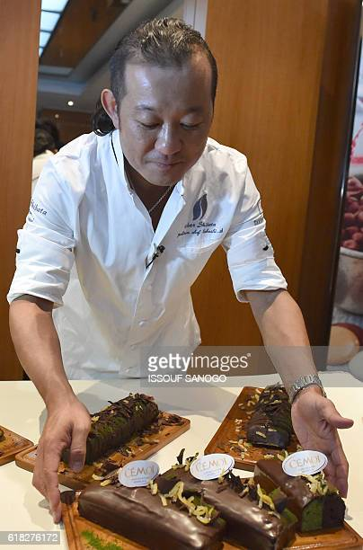 Japanese pastry chef Takeshi Shibata presents on October 25 in Abidjan a new food creations using cocoa from Ivory Coast the world's largest producer...