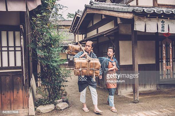 Japanese Peasant with Burden and His Son, Edo Period, Kyoto