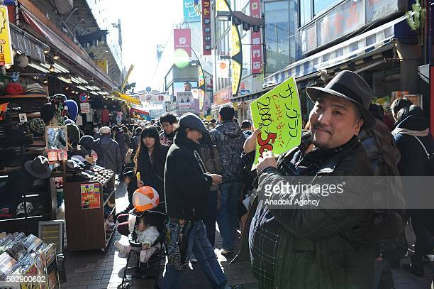 Japanese people do shopping as they prepare to celebrate the New Year at Yameyokocho and Uechu the most famous and the oldest New Year Tokyo Markets...