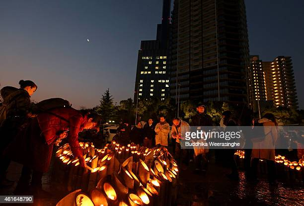 Japanese people lights up a bamboo lantern as offer a silent pray for the victims of the Great Hanshin Earthquake marking the 20th anniversary on...