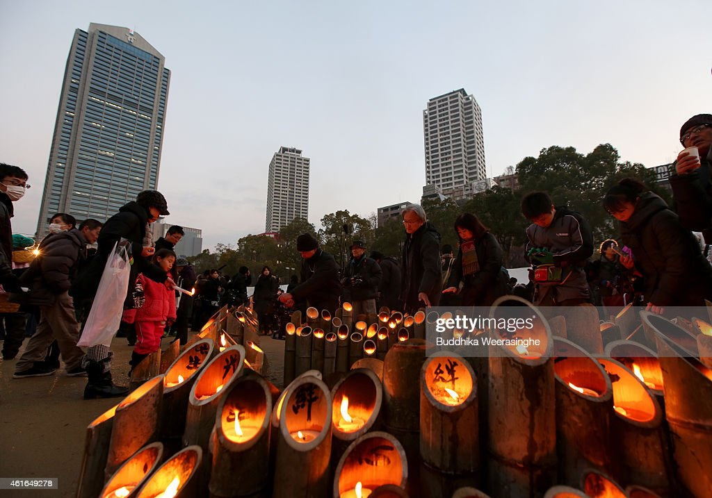 Japanese people lights up bamboo lanterns as offers of a silent pray for the victims of the Great Hanshin Earthquake marking the 20th anniversary on...