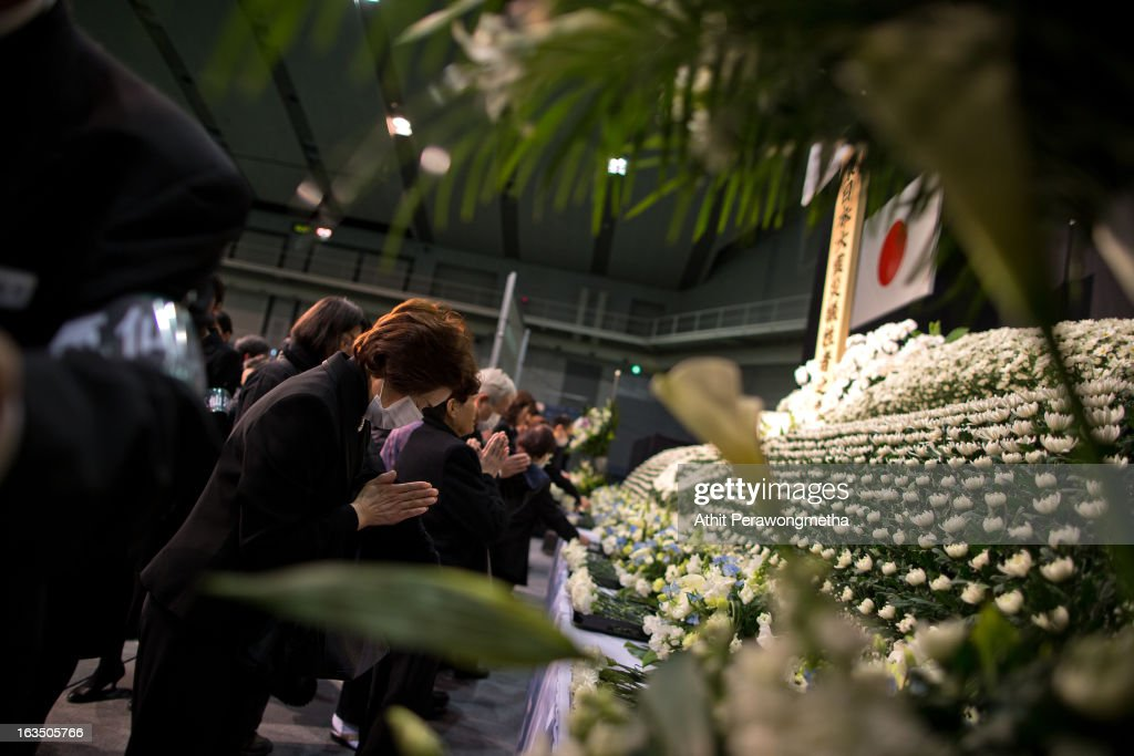Japanese people pay their respect during a memorial ceremony to commemorate the victims of the 2011 earthquake and subsequent tsunami on March 11, 2013 in Kesennuma, Japan. Japan is commemorating the second anniversary of the 2011 Magnitude 9.0 earthquake and subsequent tsunami that claimed more than 18,000 lives.