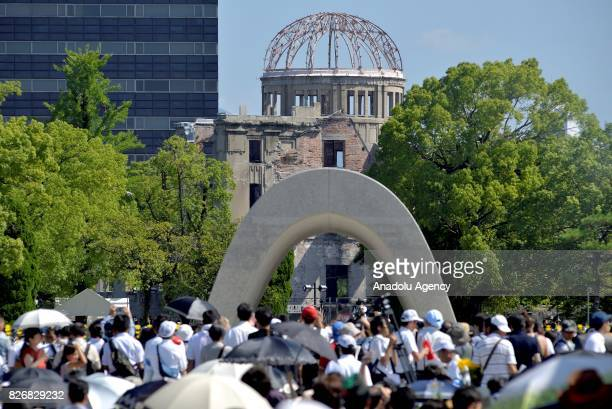 Japanese people pray in front of the Cenotaph for the Bomb Victims at the Hiroshima Peace Memorial Park on August 6 2017 in Hiroshima Japan Japan...