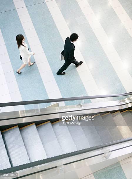 Japanese people walking in building