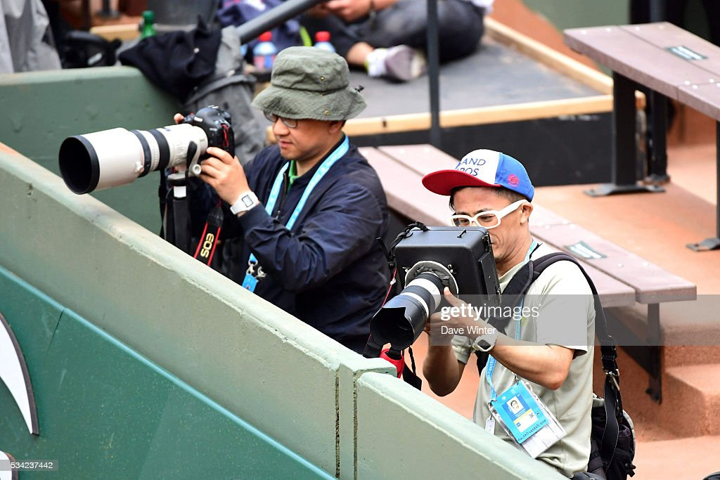 A Japanese photographer with his camera in a sound muffling box during the Men's Singles second round on day four of the French Open 2016 at Roland Garros on May 25, 2016 in Paris, France.