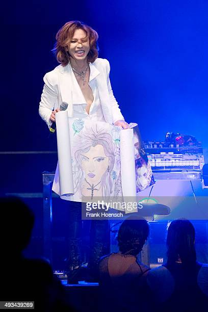Japanese pianist Yoshiki Hayashi performs live during a concert at the Tempodrom on May 23 2014 in Berlin Germany