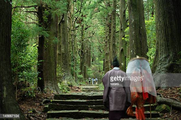 Japanese pilgrims on ancient trail in forest