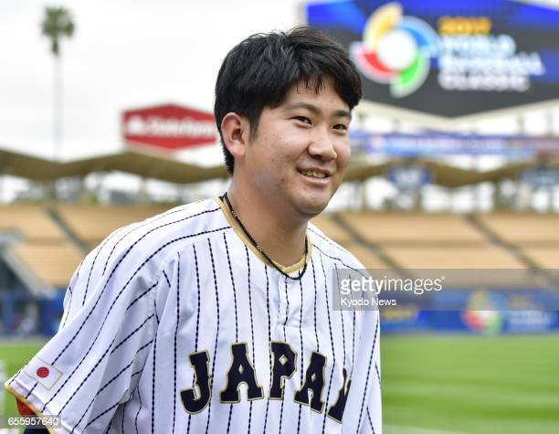 Japanese pitcher Tomoyuki Sugano takes part in team workout at Dodger Stadium in Los Angeles on March 20 for the following day's World Baseball...