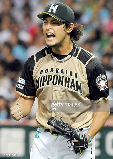 Japanese pitcher Yu Darvish of NipponHam Fighters shouts during a professional baseball game against Softbank Hawks in Fukuoka on September 17 2011...